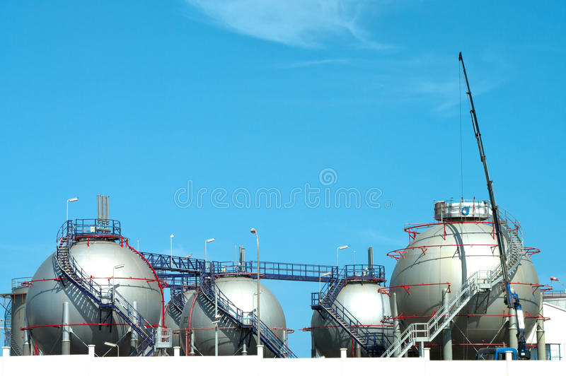 Oil refinery factory. Tanks in oil refinery factory royalty free stock image