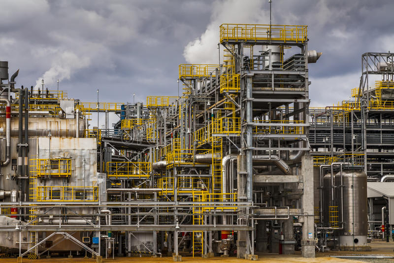 Oil Refinery factory at the cloudy sky, petrochemical plant, royalty free stock images