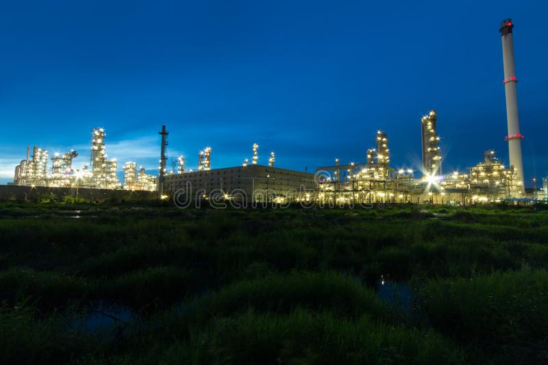Oil Refinery factory in evening, Petroleum, petrochemical plant stock photo