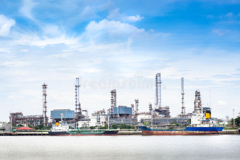 Oil refinery factory. Petroleum oil refinery factory on riverside in Thailand stock photography