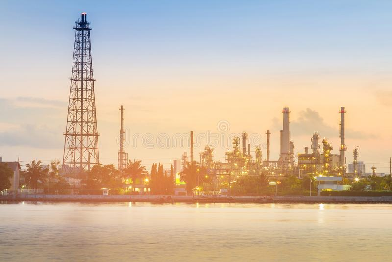 Oil refinery factory plant river front. Industria background stock photos
