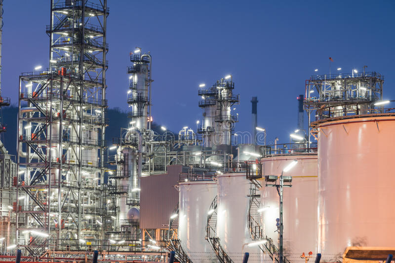 Oil Refinery factory at sunset. Petroleum, petrochemical plant stock photo