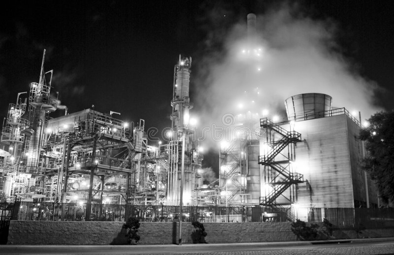 Oil refinery & industrial complex. An oil refinery in the United States with a series of foggy and smoky stacks. Industrial complex and refinery stack and smock royalty free stock photo