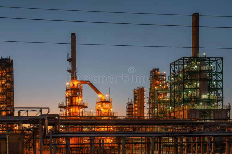 Oil refinery industrial plant or factory panorama, storage distillery tanks and steel pipeline, modern petrochemical technologies. Toned stock photos