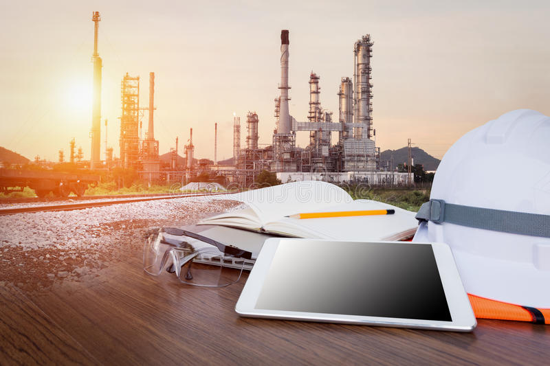 Oil refinery industry business plant. Working table engineer with tablet and tools in oil refinery industry business plant stock photo