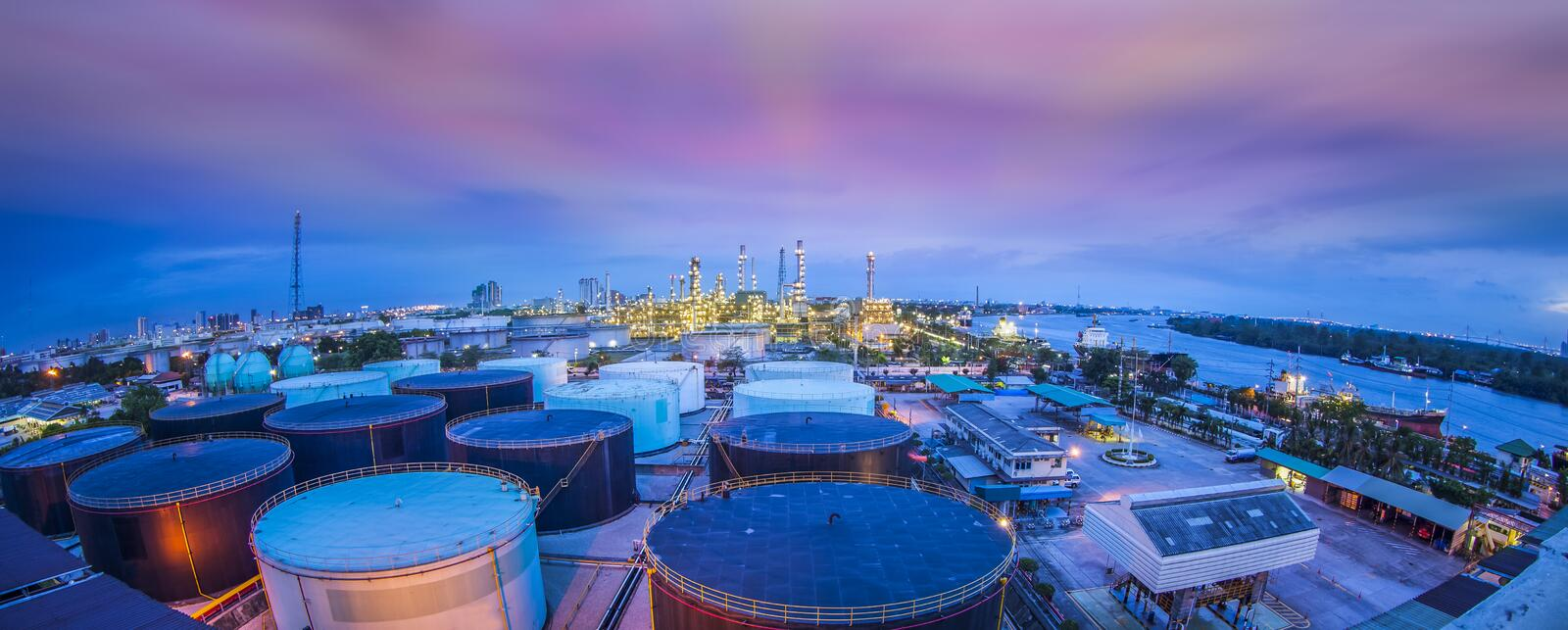 Oil refinery industry with oil storage tank. Landscape of oil refinery industry with oil storage tank royalty free stock image