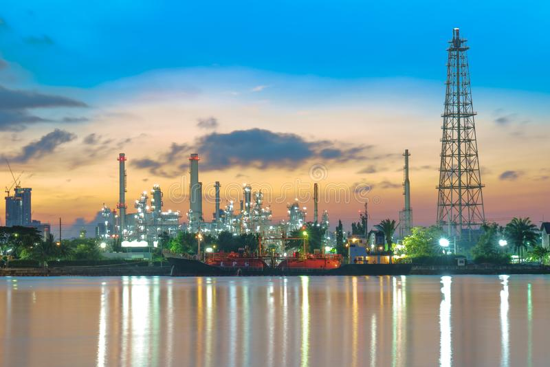 Oil refinery industry plant along twilight morning stock images