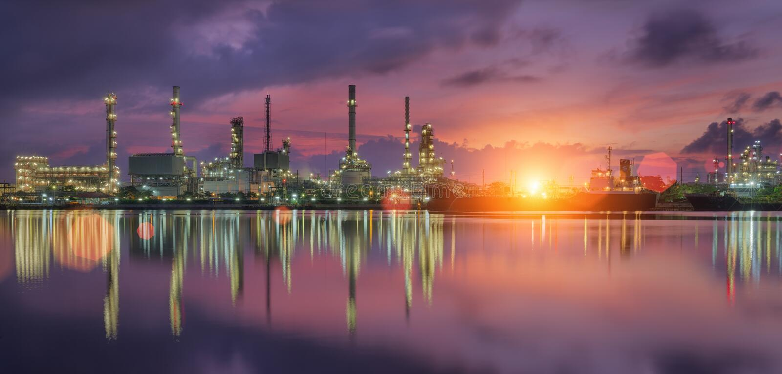 Oil refinery. Industry with tube and oil tank along twilight sky royalty free stock photography