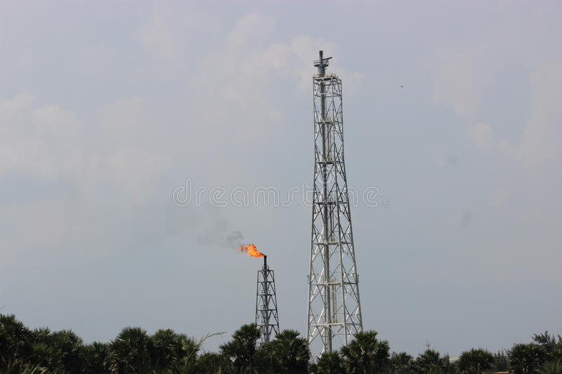 Oil Refinery. Oil and natural gas refinery tower stock photos