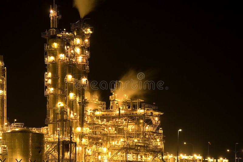 Oil Refinery at Night. Equipment at an oil refinery facility royalty free stock photos