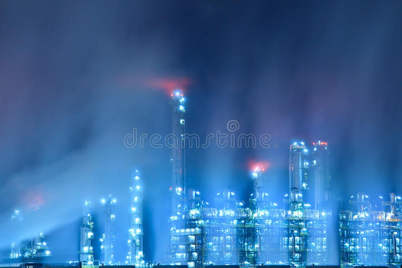 Oil refinery at night. Scenic of petrochemical oil refinery plant shines at night royalty free stock photo