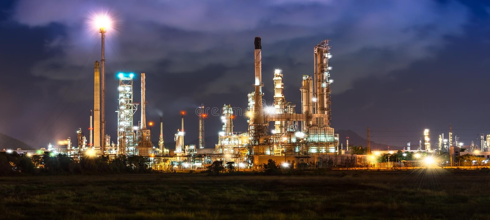 Oil refinery in night time stock photography