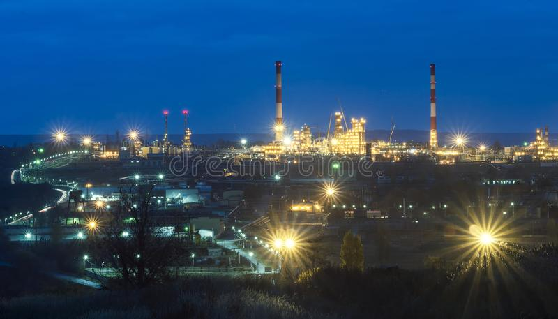 Oil refinery. In the evening, under artificial lighting royalty free stock photography