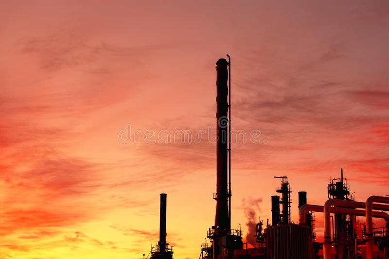 Oil Refinery. Industrial plant and warm color sky royalty free stock photos