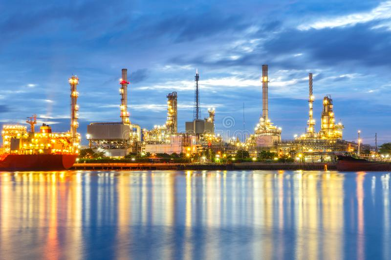 Oil refinery. At twilight with dark sky background royalty free stock photography