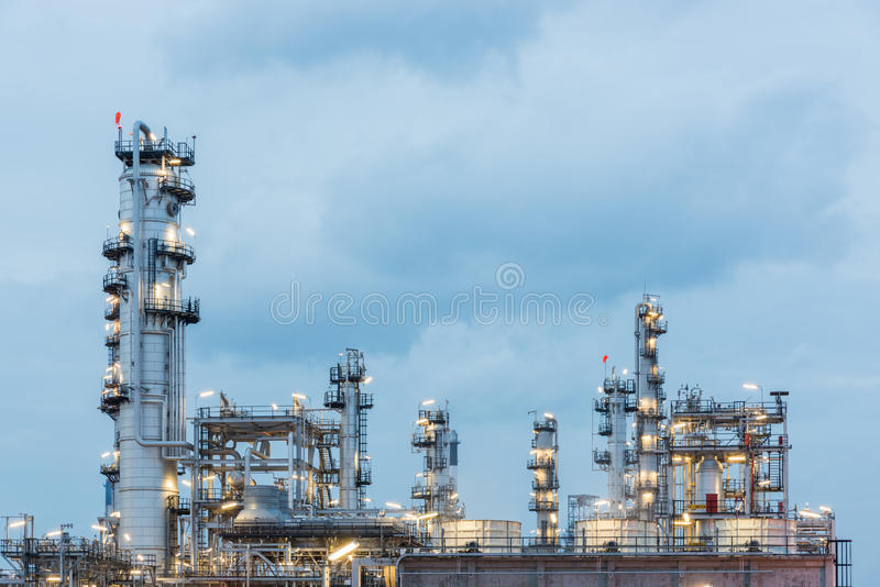 Oil refinery and Petroleum industry at night time. Sunset, petrochemical industrial stock photography