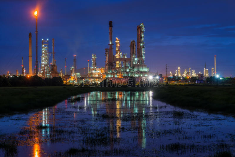Oil refinery or petroleum refinery industry landscape with reflection at twilight time in the morning. Industrial estate. Of Thailand, industrial process plant royalty free stock photography
