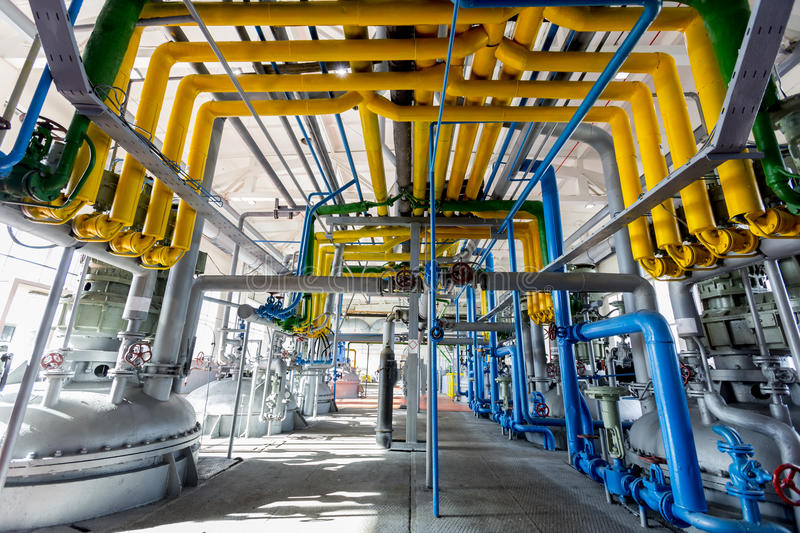 Oil refinery. Pipelines of an oil refinery from the inside stock image