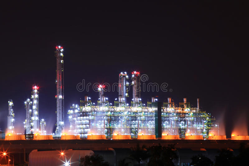 Oil refinery plant. Beautiful scenic of petrochemical oil refinery plant shines at night royalty free stock photos