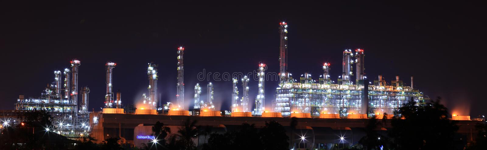 Oil refinery plant. Panoramic view of oil refinery plant at night royalty free stock photography