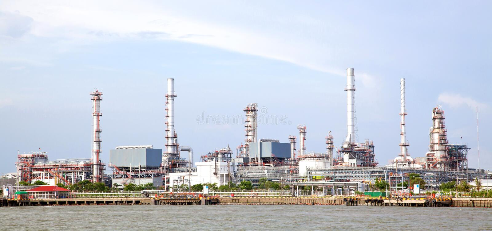 Oil refinery plant. Panorama landscape of Oil refinery plant along river stock photography