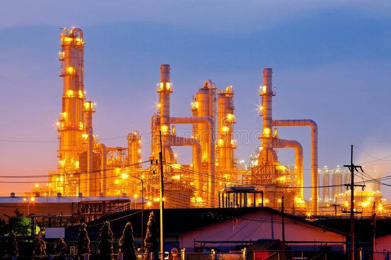 Oil Refinery Plant. Architecture of Oil Refinery Plant with distillation tower with Sunrise Twilight stock images