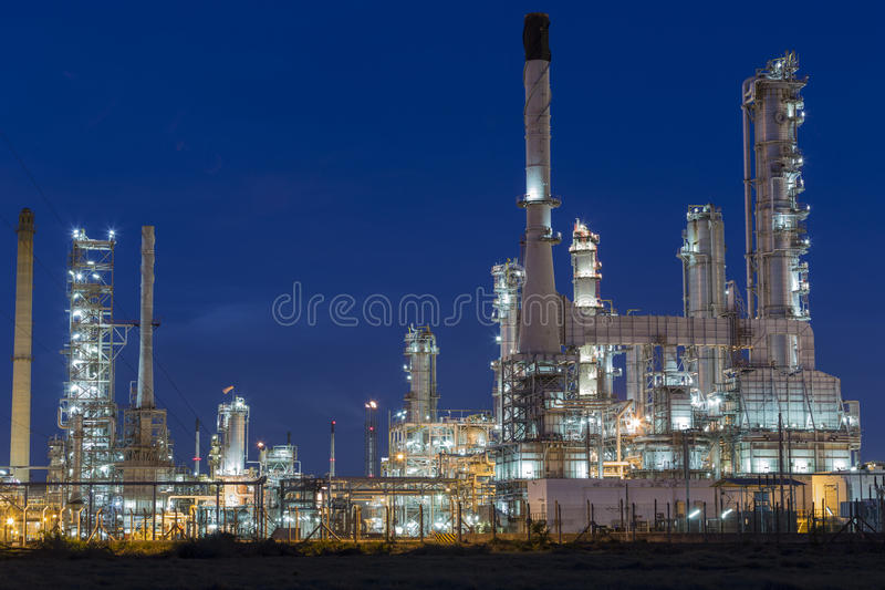 Oil refinery plant against. With blue sky stock photography