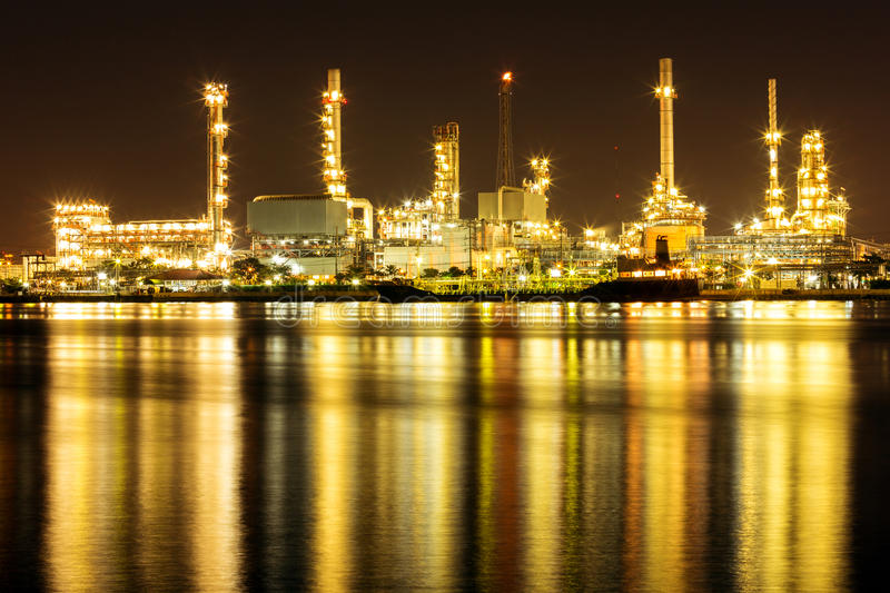 Oil Refinery Plant. Along river with tanker loading royalty free stock image