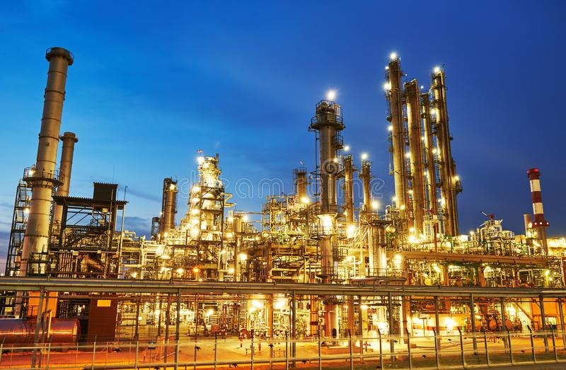Oil refinery plant or factory. Of petroleum or petrochemical industry production at sunset royalty free stock photography