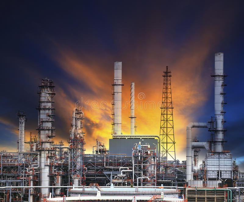 Oil refinery plant in heavy industry estate against beautiful du. Sky sky use for petrochemical industrial and fuel energy business stock image