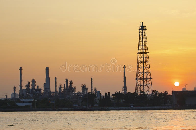 Oil refinery plant in industry estate against sun rising in morning royalty free stock photos