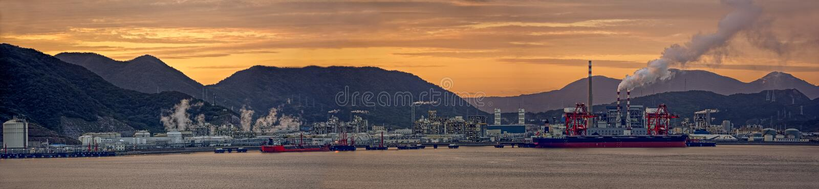 Oil refinery plant at sunset stock photos