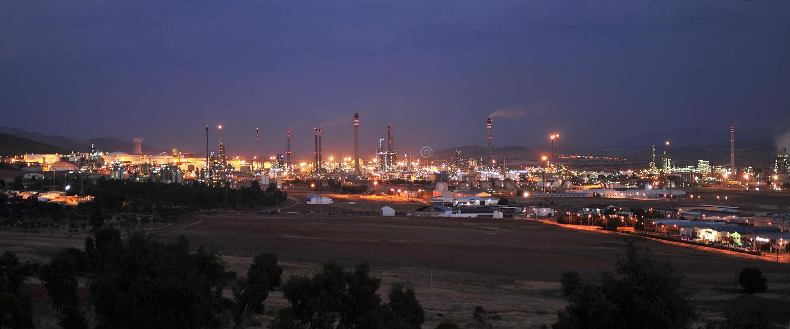 Oil refinery of Puertollano at night, Ciudad Real province, Spain. Petrochemical industrial complex for production of petroleum products located in Puertollano royalty free stock image