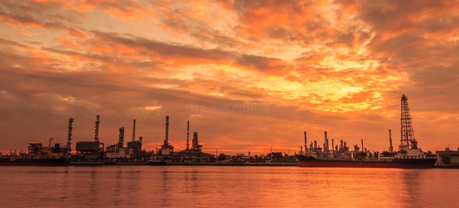 Oil refinery. Reflection of oil refinery on the water surface stock image