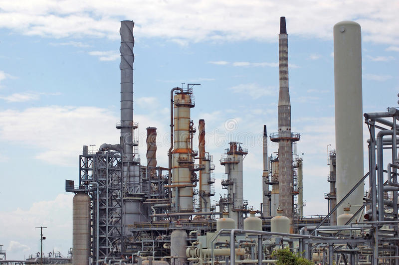Oil refinery. Refractory towers at oil refinery royalty free stock images