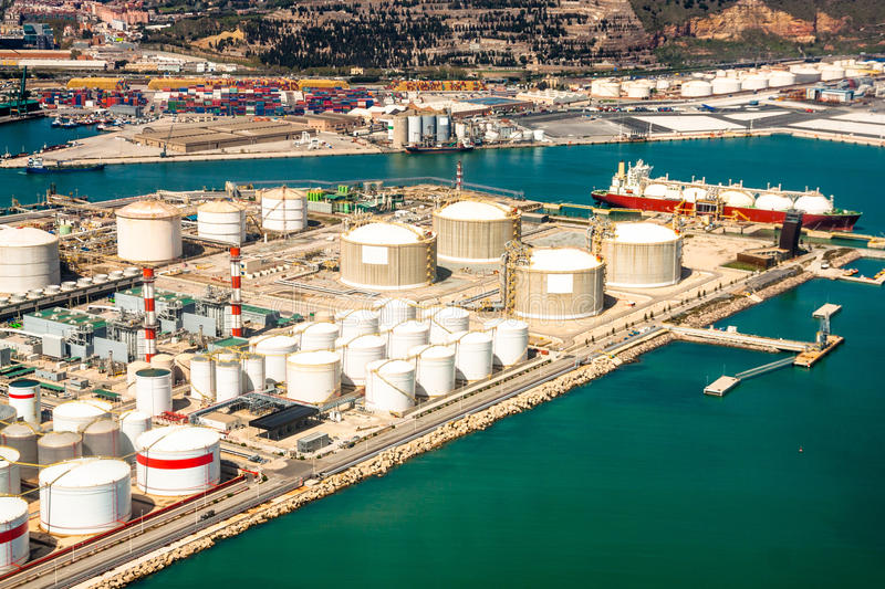 Oil refinery - sea port. Aerial photo of oil refinery area with petrol tanks and cargo port with ship stock photos