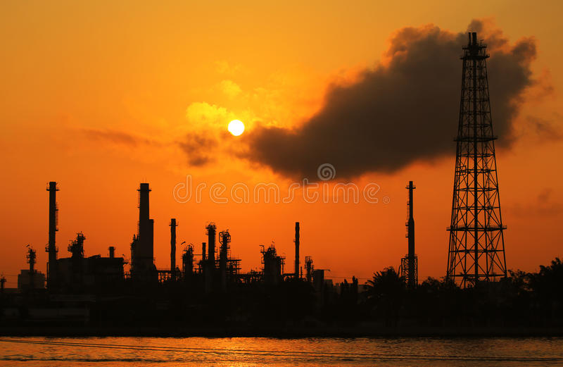 Oil refinery silhouette. At sunrisee royalty free stock photo