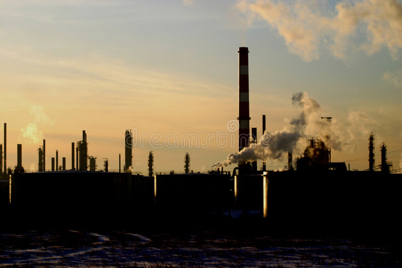 Download Oil refinery silhouetted stock photo. Image of chimney - 5202454