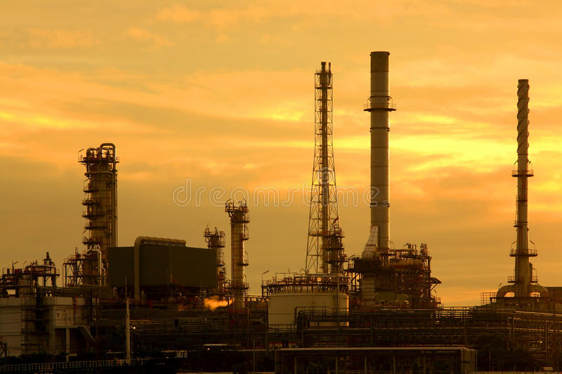 Oil refinery at sunrise. Oil refinery at twilight, Chao Phraya river, Thailand royalty free stock photos