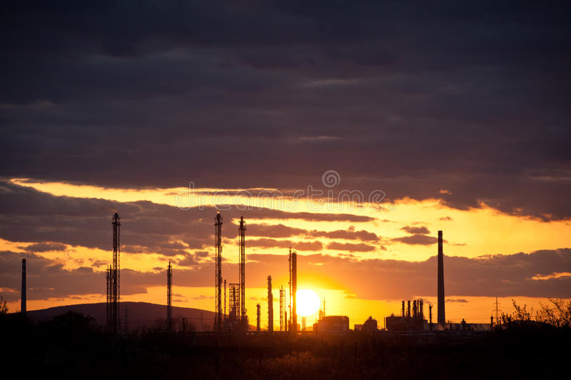 Oil refinery at sunset. Silhouette of oil refinery at sunset royalty free stock photography