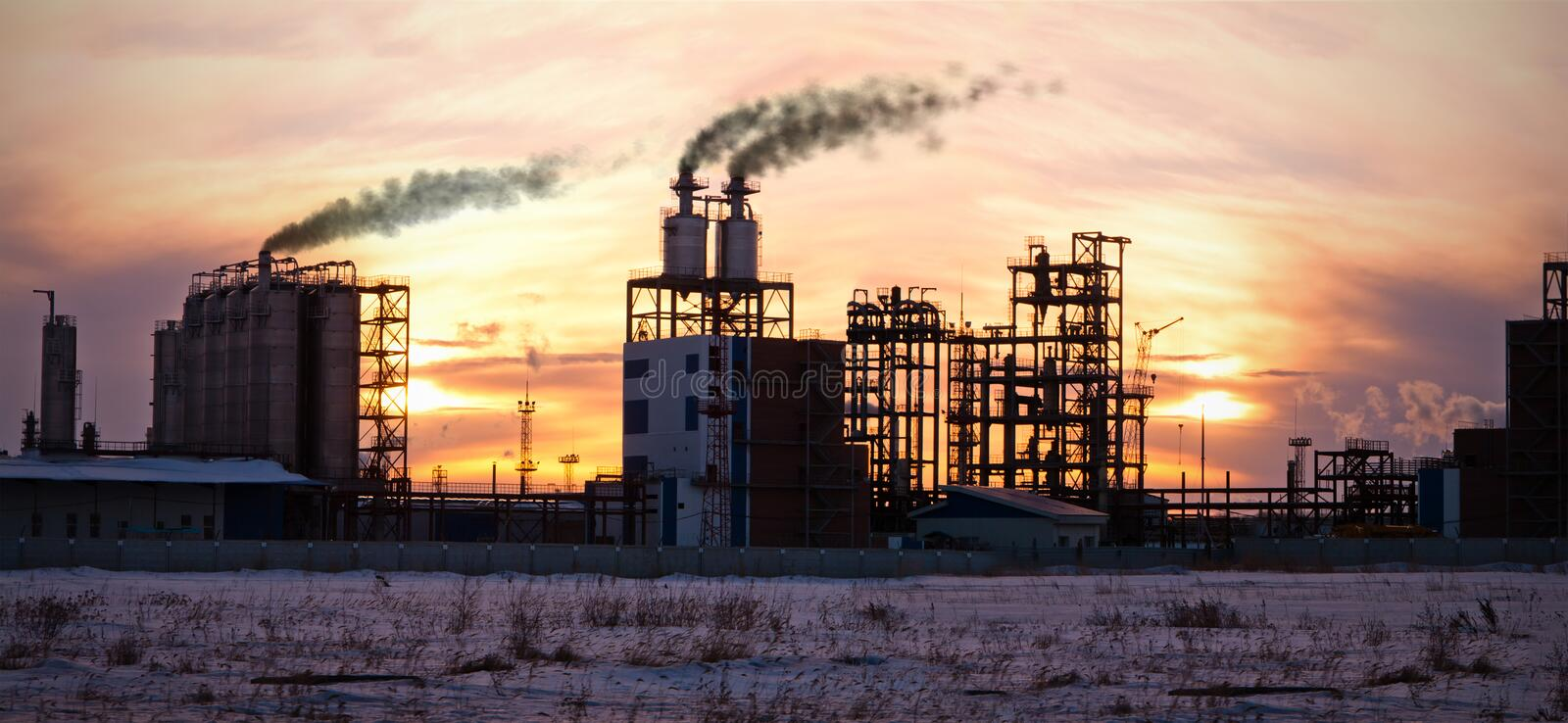 Oil refinery at sunset. Enviroment pollution. royalty free stock photography