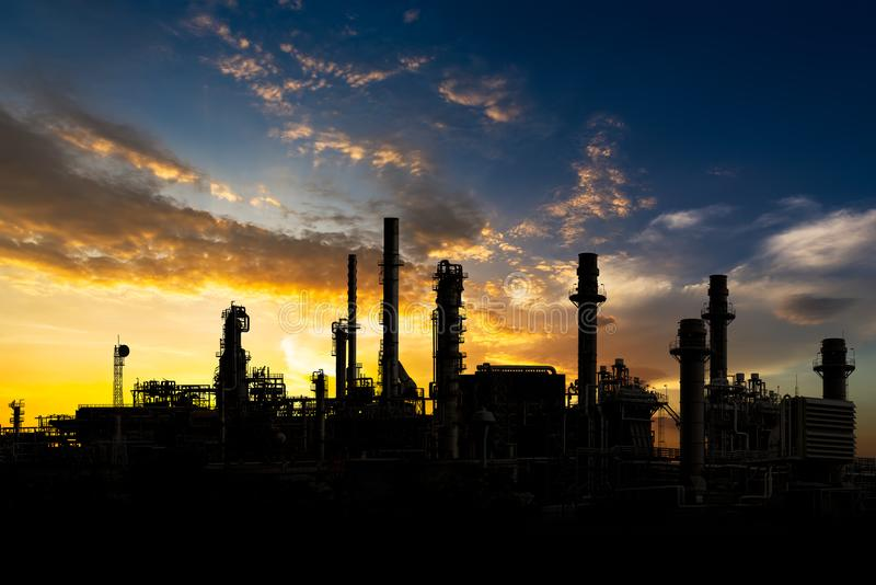 Oil refinery on sunset stock images
