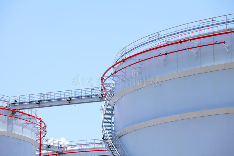Oil refinery tank. With blue sky royalty free stock images