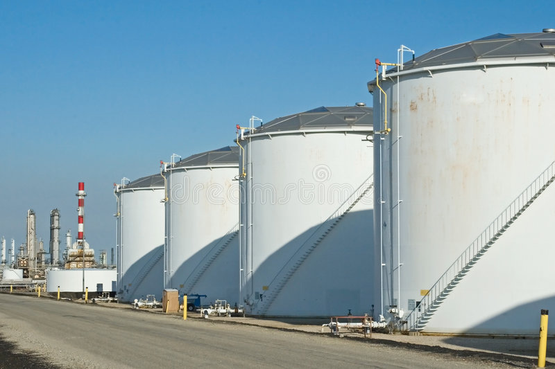 Oil Refinery Tanks. The storage tanks at an oil refinery complex stock image