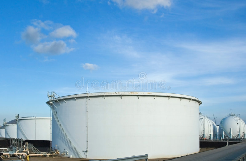 Oil Refinery Tanks. The storage tanks at an oil refinery complex royalty free stock photography