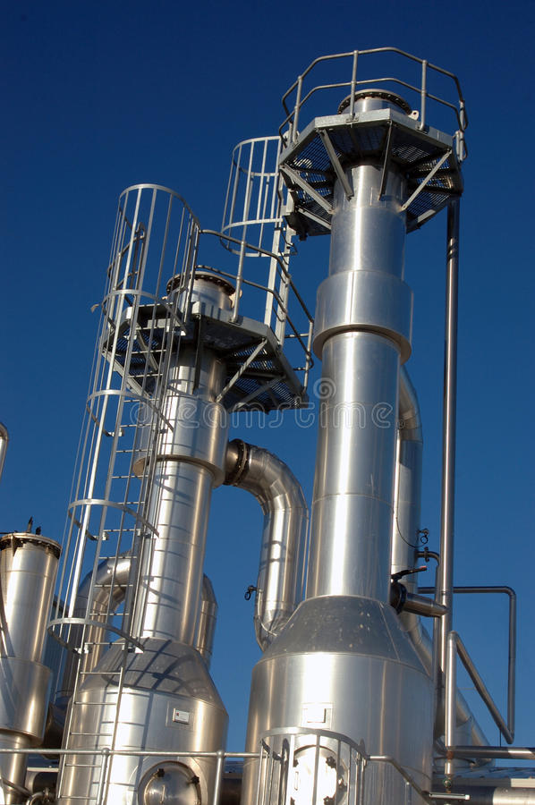 Oil refinery towers. Towers at an oil refinery royalty free stock photo