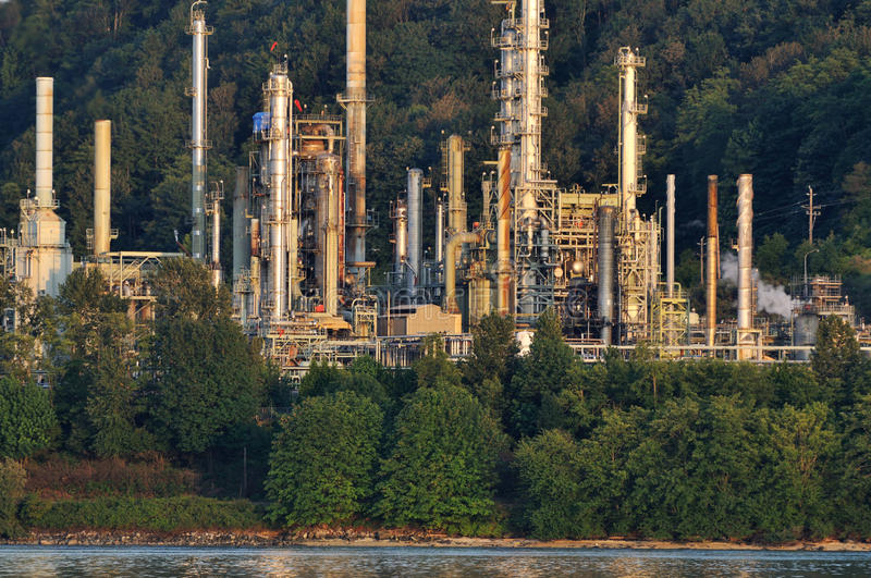 Oil Refinery towers. At sunset stock photography