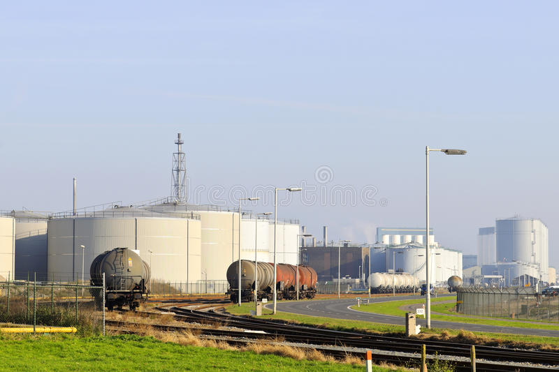 Oil refinery with train fuel tankers. Oil and chemical refinery in the port of rotterdam royalty free stock images