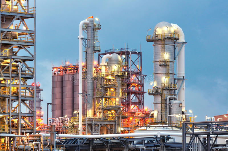 Oil refinery at twilight. Oil refinery plant at twilight time stock image