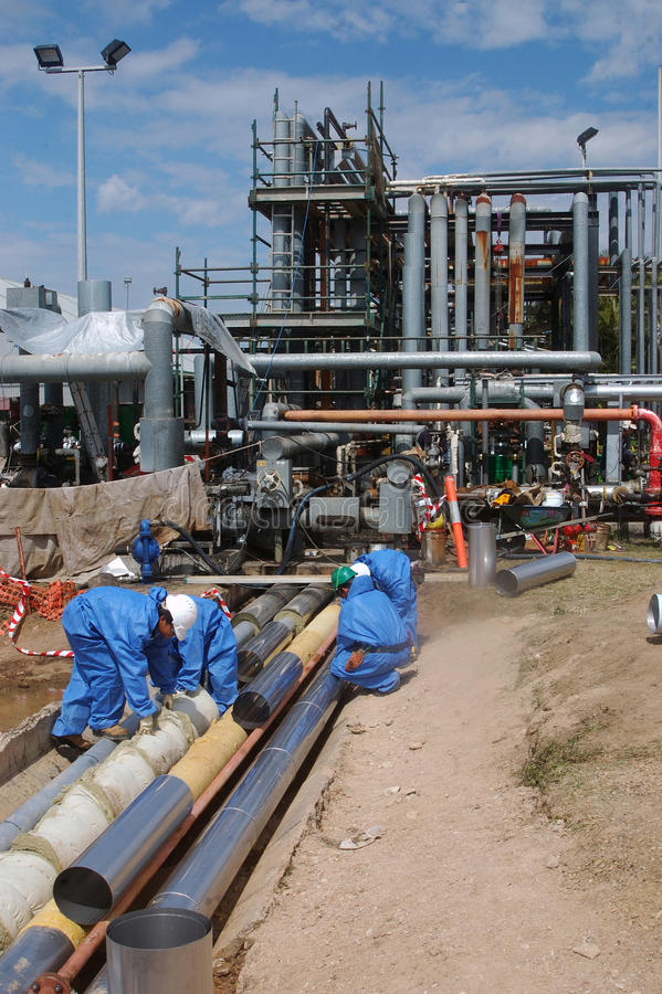 Download Oil refinery workers editorial stock image. Image of people - 33768419
